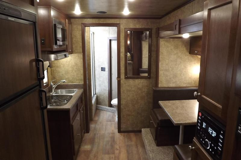 2017 Exiss Escape 7410 Dinette- Electric Awning-Lower Stud Panel- Solid Wood Cabinets & Doors - 10' SW - 4 Horse Living Quarters Trailer
