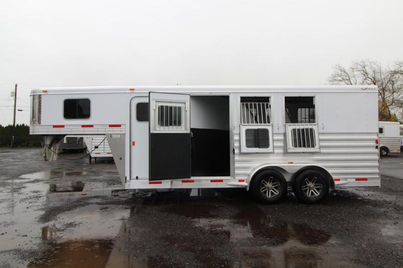 2018 Exiss 7300 - Polylast flooring - Stud divider - Escape door - Jail bar dividers - 3 Horse Trailer W/ Rear tack