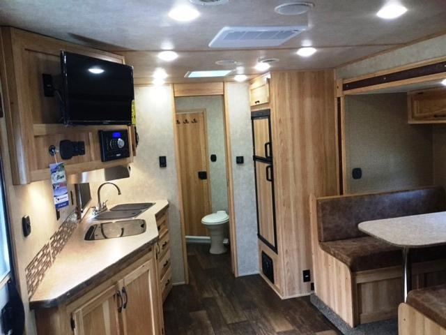2018 Bison Trailers 8315LDBLRSL LAREDO SOFA AT GN WALL WITH DINETTE I Horse Trailer