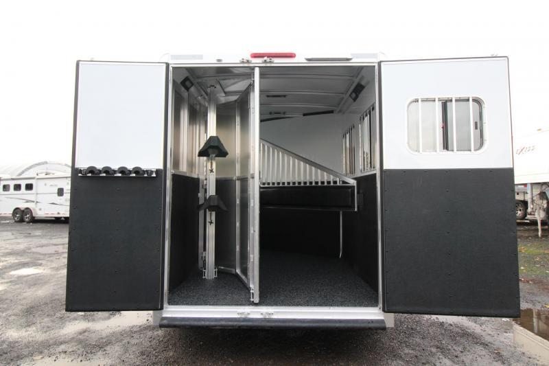 "2018 Exiss 7200 - 7' 6""Tall - Polylast flooring - Jail bar dividers - 2 Horse Aluminum Trailer"