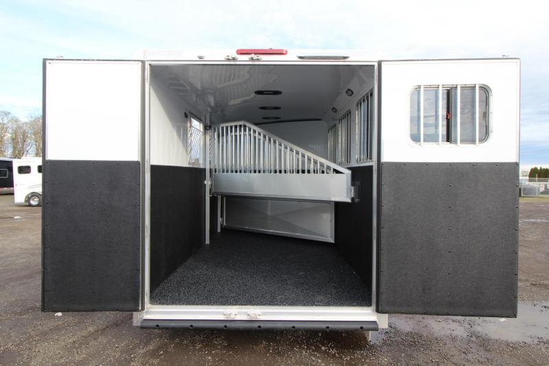 2018 Exiss 730 - Lined and insulated - Large tack room w/ swing out saddle rack - Escape Door Lots of Upgraded 3 Horse Trailer w/ Polylast Flooring