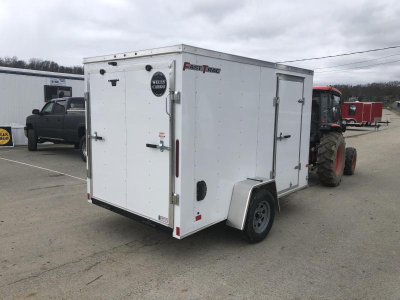 "2019 Wells Cargo 6x12' Fastrac Enclosed Cargo Trailer 2990# GVW * WHITE EXTERIOR * RAMP DOOR * 6'6"" HEIGHT * .030 ALUMINUM * 1PC ROOF * TIE DOWNS"