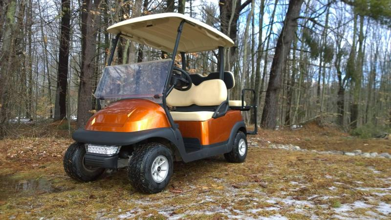 Atomic Orange Metallic Club Car Electric 4 Pass Golf Cart