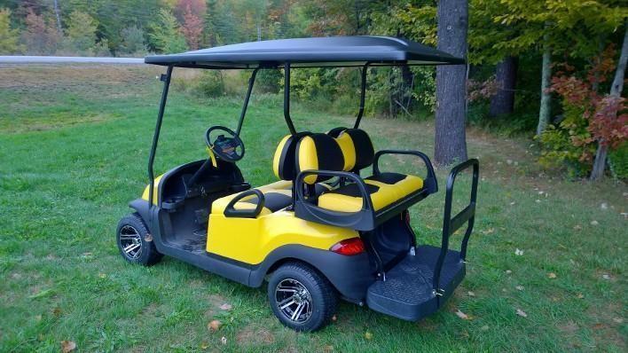 Yellow/Black Club Car Precedent Custom 4 pass elec golf cart