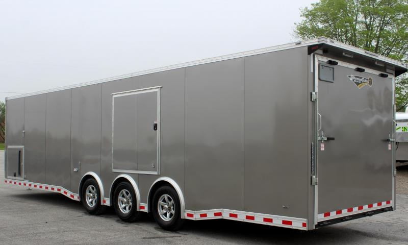 <b>Now Available w/Escape Door</b> 2020 32' Millennium Extreme Enclosed Car Trailer Red Cabinets & Wing