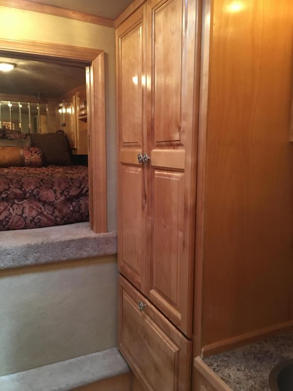 2005 Platinum Coach 4 Horse with a 14 ft Short Wall Horse Trailer