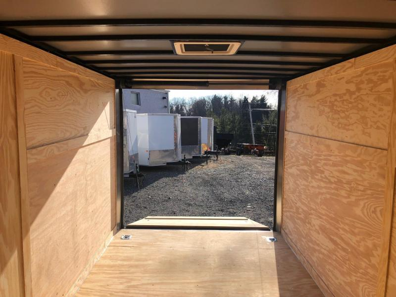 ROCK SOLID 2019 7' x 14 TANDEM AXLE SILVER WITH BLACKOUT PACKAGE SEMI SCREWLESS V-NOSE ENCLOSED TRAILER