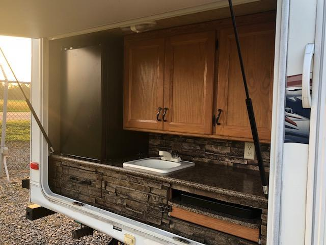 Prime Time 318 BHS Camper with 2 slide outs & out side kitchen