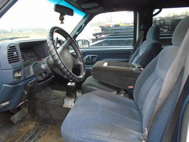 1996 Chevrolet Tahoe SUV with plow
